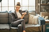 Business Woman With Coffee Latte In Loft Apartment