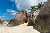Big Granite Rocks on White and Blue Sky Above at Famous Seychelles - The Tropical Island Paradise.