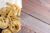 Raw Pasta On A Wooden Background