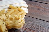 Raw Pasta On A Wooden Table