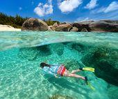 Split photo of young woman snorkeling in turquoise ocean water among granite boulders on Virgin Gorda, British Virgin Islands, Caribbean