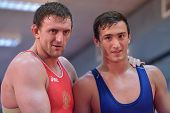 NOVOSIBIRSK, RUSSIA - OCTOBER 16, 2014: Greco-Roman wrestling World Cup winner Vasily Teploukhov (left) on the open training. The event aimed to promote the  Friendship Cup which starts on November 8