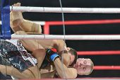 NOVOSIBIRSK, RUSSIA - NOVEMBER 8, 2014: Mixed martial arts match Kasum Kasumov vs Alexander Matmuratov during the Friendship Cup. The competitions include 10 kind of martial arts