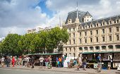 Street Souvenir Shops With Tourists In Paris