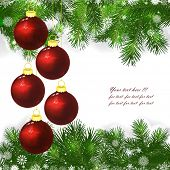 Christmas background with Christmas balls and green branches of Christmas tree.