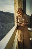 FRANCE, CIRCA SIXTIES- Vintage photo of woman on balcony