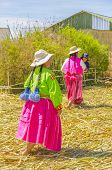PUNO, PERU, MAY 5, 2014: Local women in traditional attire on one of Uros Islands (Lake Titicaca)