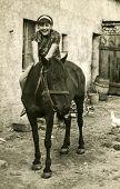 LODZ, POLAND, CIRCA SIXTIES - Vintage photo of woman sitting on horse
