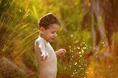 Little Boy Among Splash