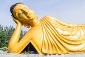 picture of recliner  - Reclining golden Buddha statue at Srisoonthorm temple Phuket - JPG