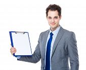 Businessman show with blank paper on clipboard