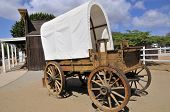 stock photo of covered wagon  - Old western wagon in San Diego - JPG