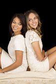 Two Women White Dress On Black Back To Back Smile