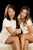 Two Women White Dresses Sit Phone Happy