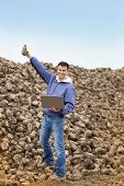 Farmer On Sugar Beet Pile
