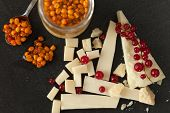 stock photo of sea-buckthorn  - Platter with different types of cheese redcurrant and sea buckthorn jam - JPG