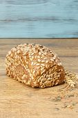 foto of whole-wheat  - Whole wheat sunflower seed bread on a table - JPG