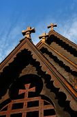 Front detail of the Reinli stave church, Sør-Aurdal, Norway, on a bright blue sky