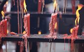 burning incenses and candle in temple,words meaning blessing