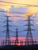 Beautiful Sunset Behind Electricity Plant Industry Estate Use As Electrical Power Background,