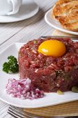 Beef Tartare With Egg And Vegetables Closeup.  Vertical
