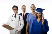 stock photo of medical doctors  - a team of young professionals including businessman - JPG