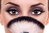 stock photo of blush  - A beautiful woman eyes and makeup brushes - JPG