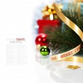 Christmas ribbon bow with christmas decorations on white background