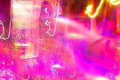 abstract pink and yellow coloured lights unfocused