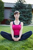 Young Fit Woman Sit On Grass Outdoor