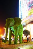 Green grass elephant sculpture