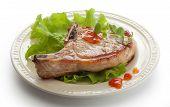 image of pork cutlet  - Fried pork cutlet with fresh green lettuce on the plate - JPG