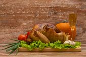 fried turkey with vegetables and glass of wine