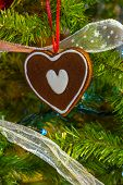 Christmas Decoration. Heart Shaped Cookie On Tree Background