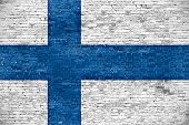 Finnish Flag Over Old Wall