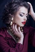 beauty rich brunette woman with a lot of jewellery