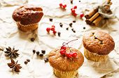 image of chocolate muffin  - muffins with cinnamon and chocolate chips on a light woody background - JPG
