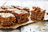 stock photo of walnut  - oatmeal cake with dates and walnuts on a dark wood background - JPG