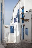 Traditional Narrow street of Sidi Bou Said with buildings with Blue doors and white walls, Tunisia