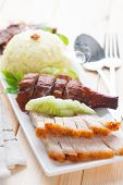 stock photo of pork belly  - Chinese roasted pork belly served with soy and seafood sauce - JPG