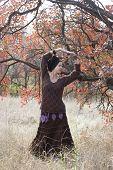 Young Beautiful Woman Dancing Outdoors