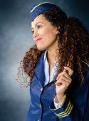 image of flight attendant  - Portrait of Attractive Female Flight attendant Smiling - JPG