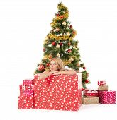 woman inside of gift box and christmas tree behind