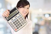 Business woman holding calculator on white background, focus on face.
