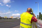 Surveyor Measuring