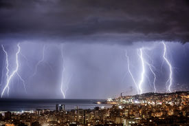 image of zipper  - Night cityscape with strong lightning - JPG