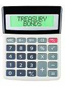 stock photo of treasury  - Calculator with TREASURY BONDS on display isolated on white background - JPG
