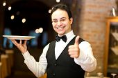 picture of waiter  - Waiter holding a plate - JPG