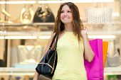 picture of shopping center  - Young woman in a shopping center - JPG