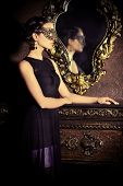 stock photo of masquerade mask  - Beautiful mysterious stranger girl in venetian mask - JPG